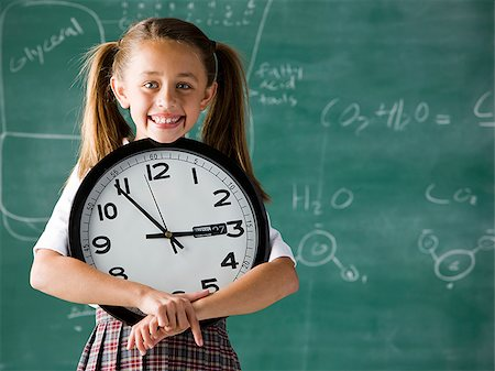 Image of young student holding clock